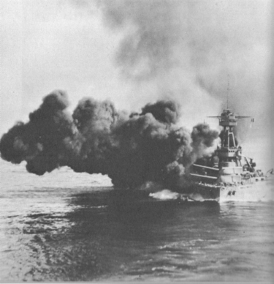 USS Texas fires a salvo of its 14-inch guns.