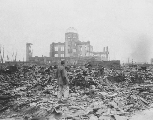 An Allied correspondent views the remains of the Genbaku Dome in Hiroshima a month after the first military use of an atomic bomb. | STANLEY TROUTMAN / AP