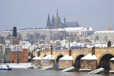 The Charles Bridge over the Vltava River, the Prague Castle and St. Vitus Cathedral above.