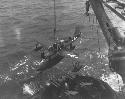 Kingfisher spotter plane is hoisted back onto deck on the  USS Texas.