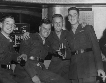 Marines from  U.S.S. Texas  on liberty in Hollywood, CA, December 1, 1944, on their way to fight in the Pacific (l to r): Robert Evans, Jacob Straub, Fred Dunikowski, Jack Pawley.