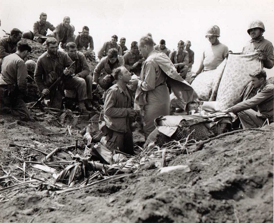 Reportedly    Lt. Charles Suver saying Mass    atop Mt. Suribachi during the invasion of Iwo Jima, February 23, 1945.