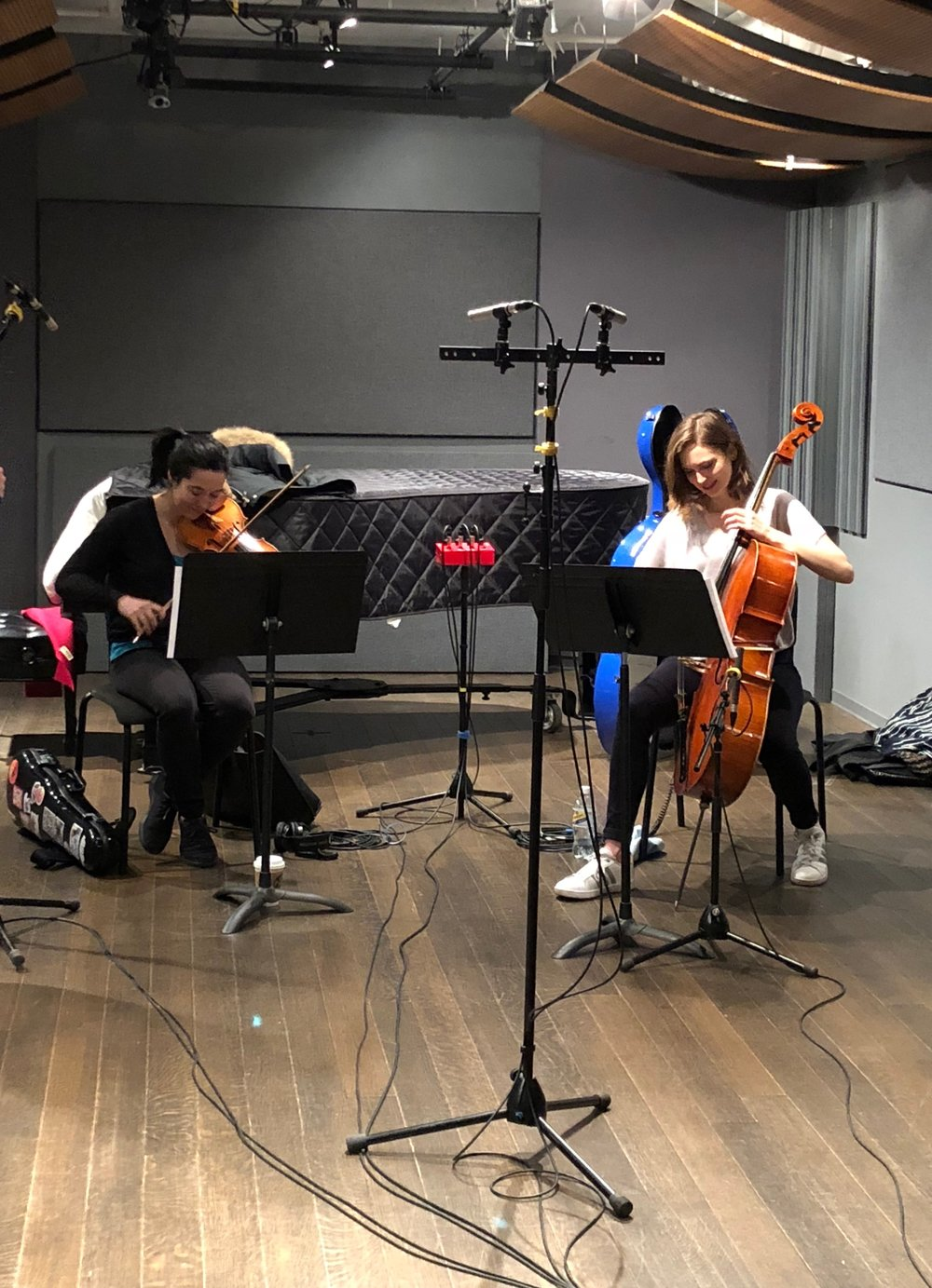 Patti Kilroy (violin) and Mariel Roberts (cello) recording the score at Dolan Studios for the MasterCard Gold Card commercial.
