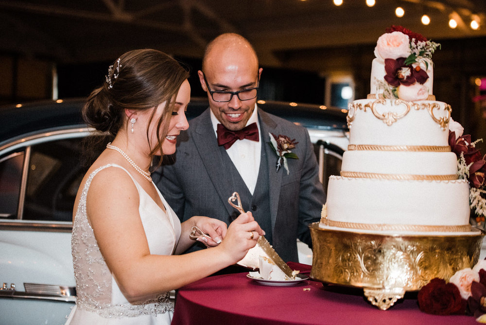 Cake cutting. Americas Packard Museum wedding