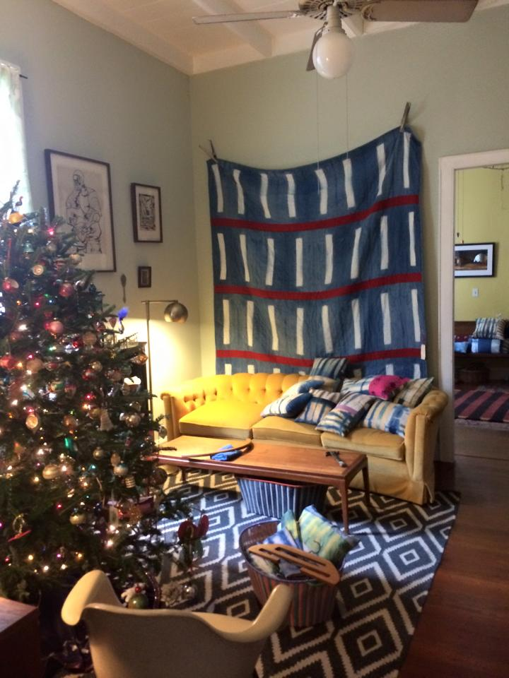 Quilts and pillows and scarves for sale at the Crosby Schoolhouse's sale in New Orleans