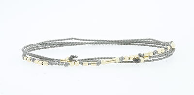 Morse code 'No Impunity' bracelet by Cass Lilien. You can purchase it here.