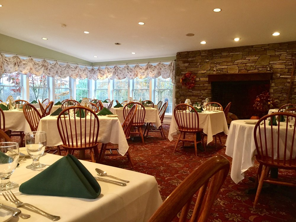 main dining room with meadow and fireplace views.jpg
