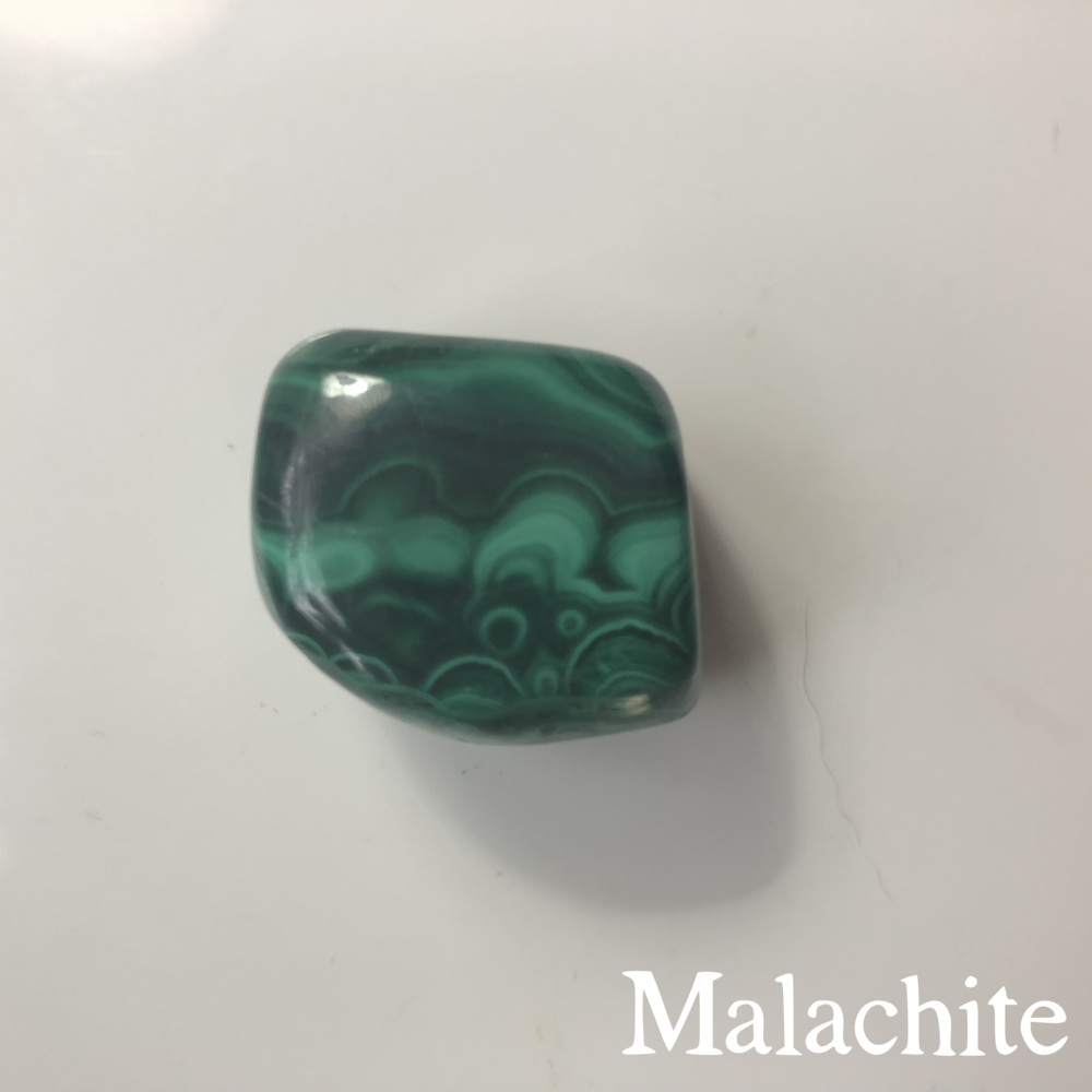 Malachite ($6.00) : This green goddess was the standout piece of the expo for me.  I wanted every bit of it I came across, including the $680.00 statement hunk I found.  I settled for this little cube, which I intend to wrap with wire and wear as a pendant.  I had no knowledge of the  properties of malachite  prior to the show, but after researching, I've found she's meant to be a stone of focused concentration and wisdom (Egyptian pharaohs wore malachite in their headdresses for this purpose).  I love those things. The vendor I purchased this stone from (and many others) has a website, but no products are listed there yet.  I'll link you to some malachite  here.