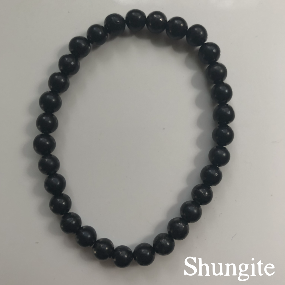 Shungite Bracelet ($12.00 ):  I'm a conspiracy theorist about EMF now.  I'm so worried about wi-fi and cell reception and everything else coursing through my body wirelessly—the stuff we really have no clue about, as it was just invented within...well, my lifetime, at least.   Shungite , mined in Russia, is supposed to help combat all breeds of negativity, and restore balance to your system, thanks to the fullerenes found within the mineral—a carbon molecule with wild free-radical battling properties.  The sticker was for my phone, but it bugged my husband so much, that I just stuck it on my nightstand instead. Buy your own  shungite bracelet here .