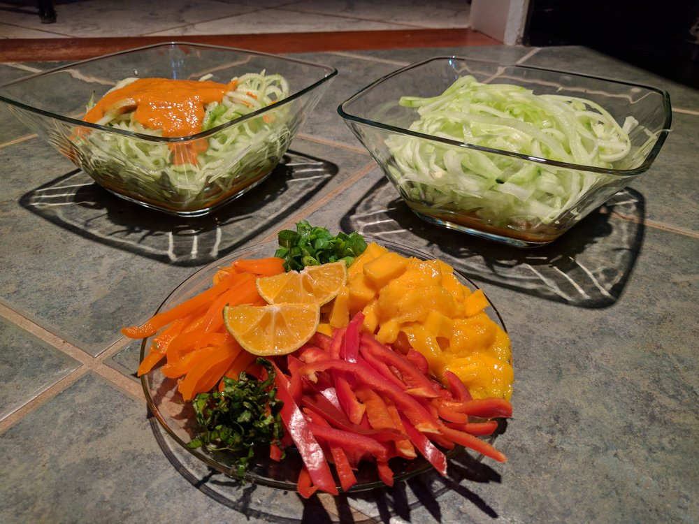 Raw Cucumber Noodles topped with romesco sauce and freshly cut fruits and vegetables.  Costa Rica