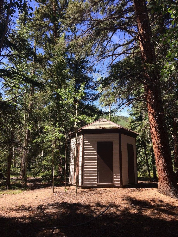 A hexagonal outhouse