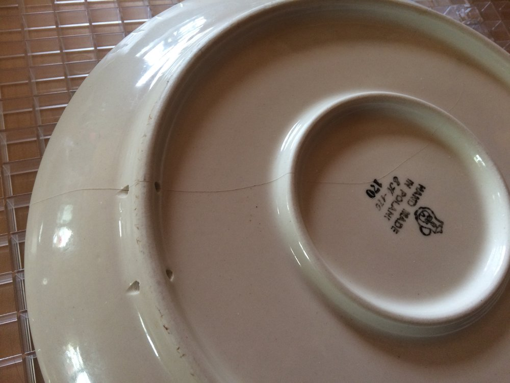 Cracked Polish pottery plate, ready to be REALLY cracked.