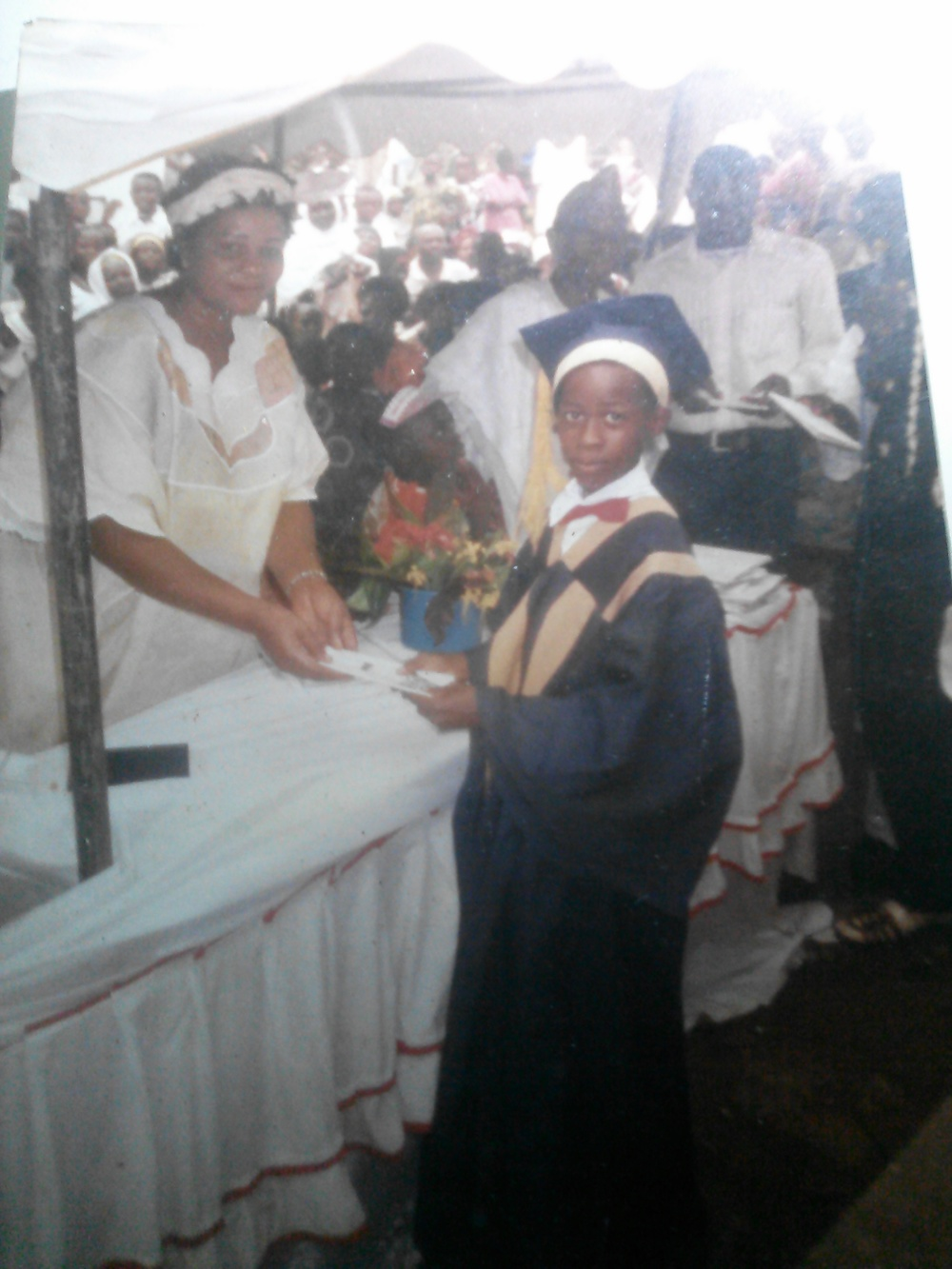 Obioma, age 11 or 12, receiving the award for best literature student at his primary school in 1998.