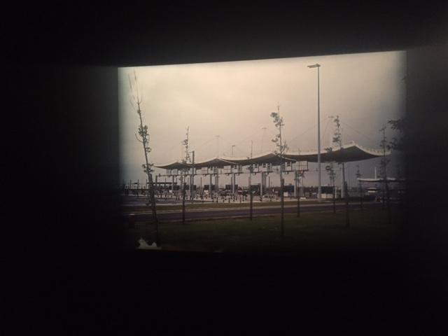 "A photograph of a tollbooth hung on a darkly painted wall, the bleak representation of suburban France at ""Michel Houellebecq: French Bashing."" The author's first art show in the US opened on Friday in New York."