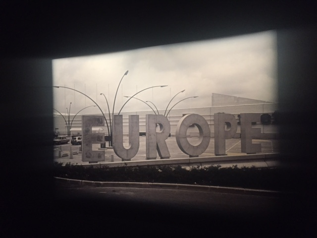 "Photograph of crumbling concrete sign of the word ""EUROPE"" at the ""Michel Houellebecq: French Bashing"" exhibit in New York"