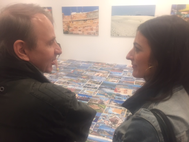 "LSP's host Prune Perromat with French lit star Michel Houellebecq commenting his art at the opening of his show ""French Bashing"" on Friday in New York. Photo Credit: Joel Whitney"
