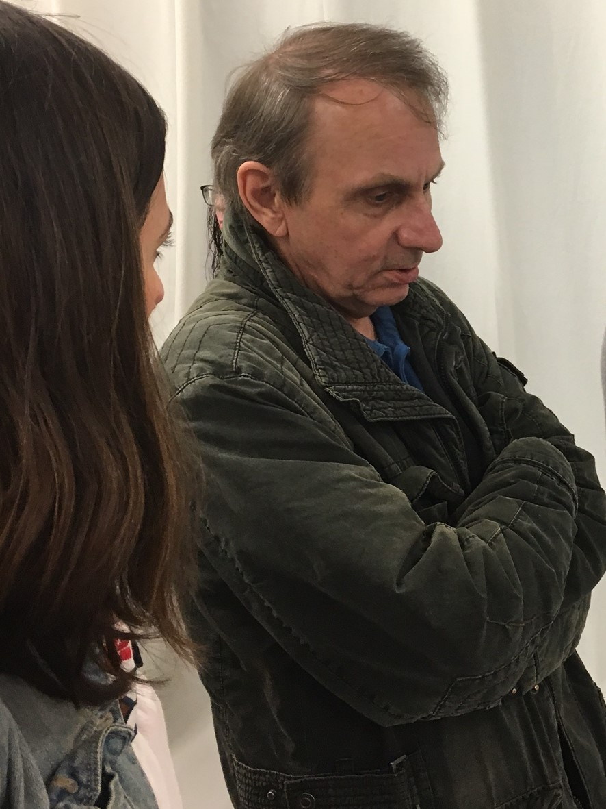 """Well, it's tourism..."" Michel Houellebecq laconically describing his art to LSP's Prune Perromat at the opening of his first US art show ""French Bashing"" in New York on Friday night. Photo Credit: Joel Whitney"