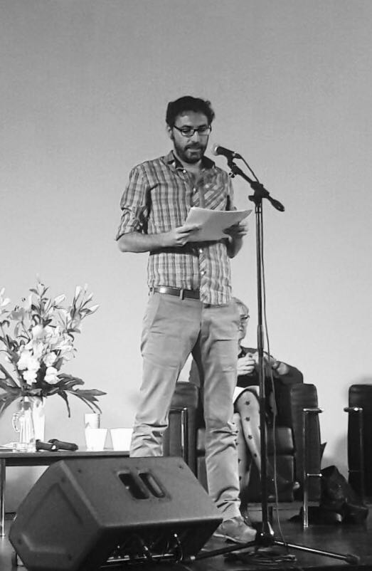 "Poet Mariano Rolando Andrade reciting his poem ""Escape a Nashville"" on stage at the FIP International Festival of Poetry of Buenos Aires (June 14-18, 2017). Photo credit: Soledad Nieto"