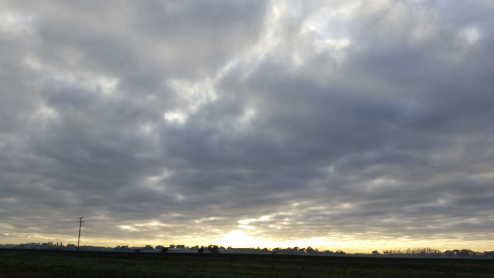 Pearlescent light on the horizon behind the clouds this morning - still very cold !