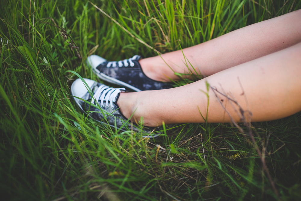 Teen's sneakers in the grass