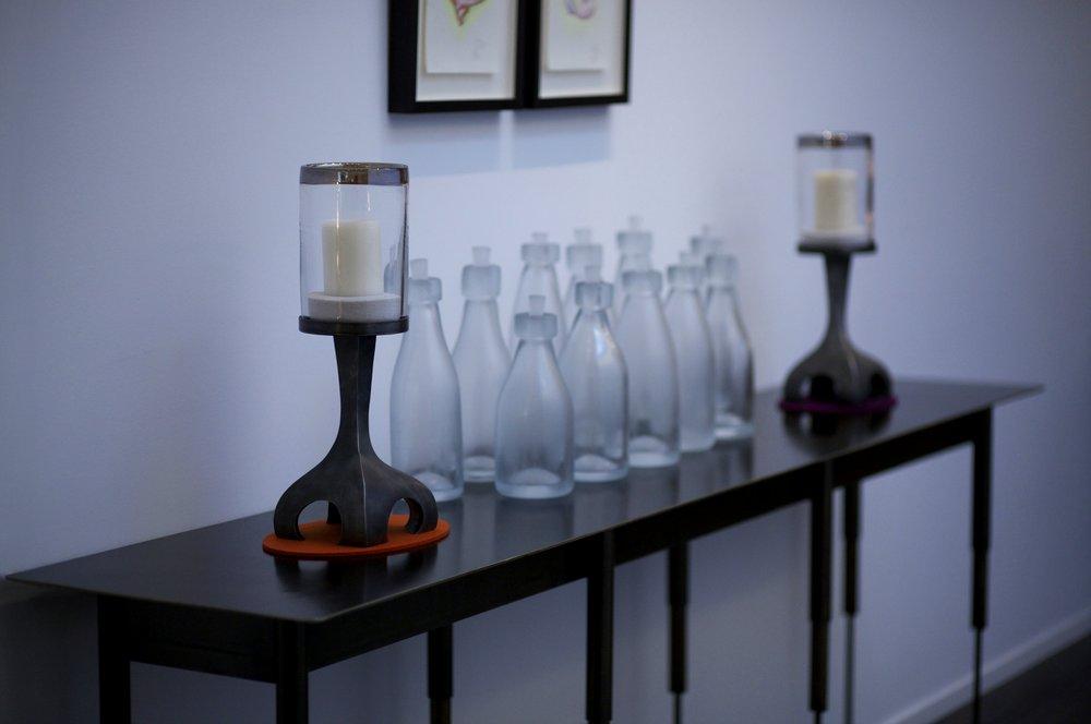 whole Melk bottles on steel table with candelabras.jpg