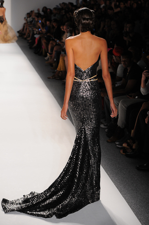 0121a6acbd Strapless black evening gown with metallic pyramid studs and crystal waist  ...