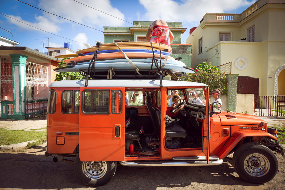 Our most excellent ride to Playa Megano - a sandy beach with beginner-friendly waves 45 minutes outside of Havana.  Transportation to these beaches is a big challenge for our Wahines because taxis can be expensive and bus drivers will not allow the oversized boards on their overcrowded buses.  Thanks to a private donor, 10 Wahines and surfboards made it to the beach!