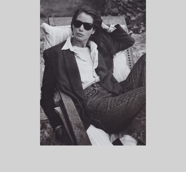 Nineties super model Christy Turlington works the pinnacle of the decade's I'm-too-cool-to-care vibe: Slouchy boyfriend blazer and shirt, Levi's, white socks, loafers, Wayfarers and great hair. We want this look right now!