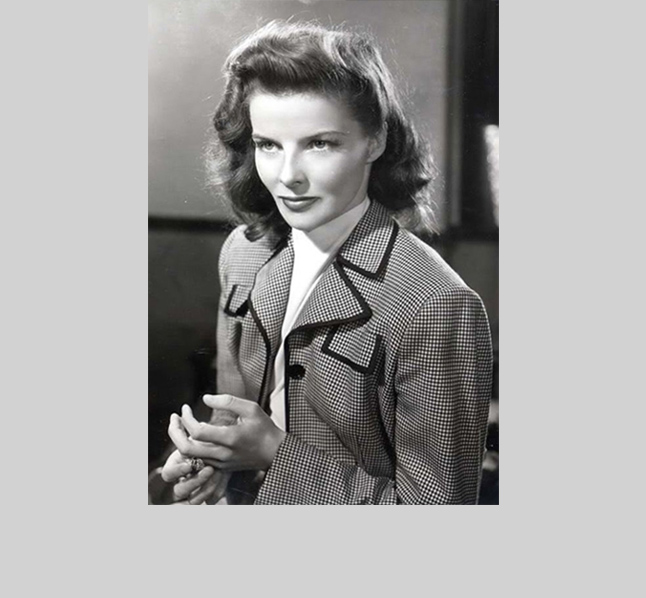 Katherine Hepburn's fierce beauty is elegantly buttoned up in the 1940's and 50's. Here she complements her inimitable cheekbones with an equestrian-style jacket with piped lapels.