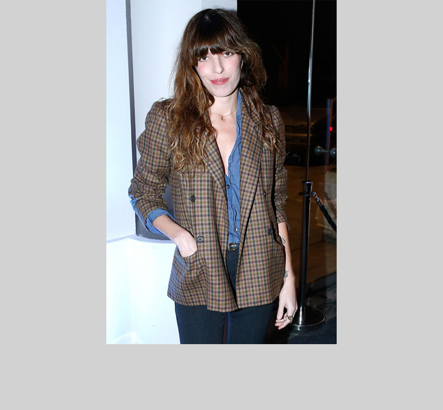 Birkin's daughter Lou Douillon channels her maman, adding a little edge with a mens-y double-breasted plaid jacket over a chambray shirt and high-waisted black jeans.