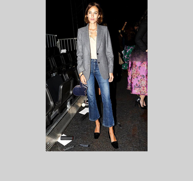 Alexa Chung -  Queen of effortless perfection, Alexa reinterprets the 1990's uniform with high rise flares and a pilgrim shoe. Alexa knows how to keep it basic in the best possible way.