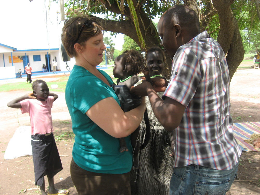 Sonya weighing a child in a nutrition program in South Sudan.