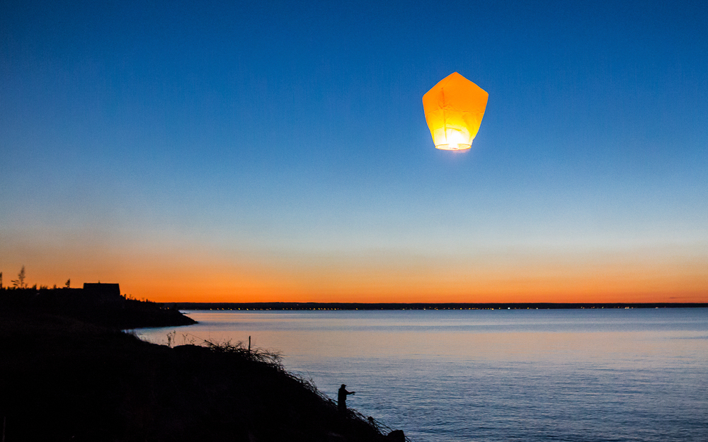 Chinese lantern over the beach at night