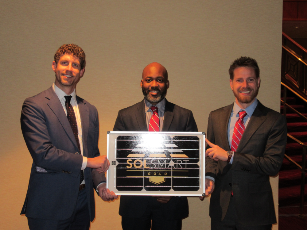 New York City accepts SolSmart Gold designation. Pictured: Henry Greenidge, Office of the Mayor, with SolSmart staff.