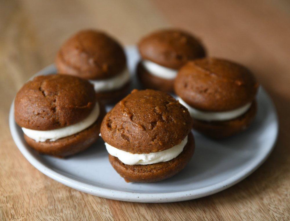 Pumpkin Whoopie Pies  Delicious pumpkin cake with a cream cheese icing center.  Half Dozen for $12
