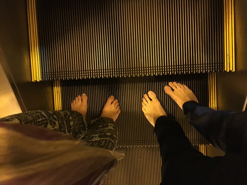 Shoe- and sock-less on the escalator!
