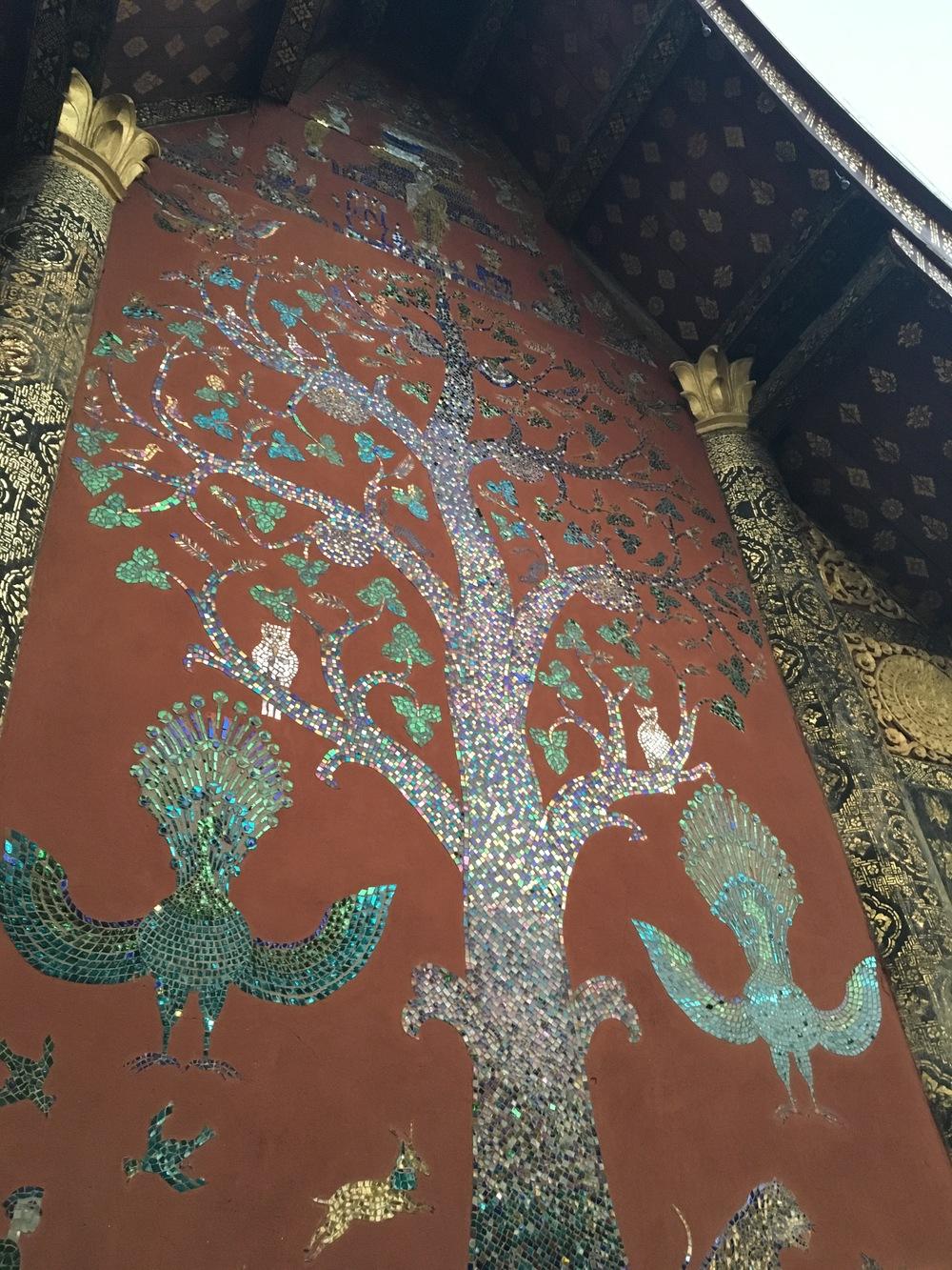 Beautiful tile mosaics at Wat Xieng Thong