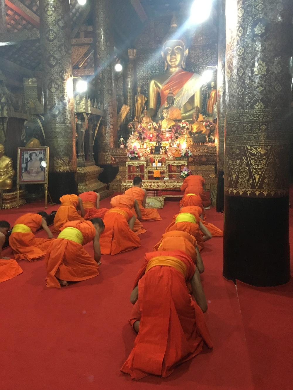 Evening prayer at Wat Xieng Thong