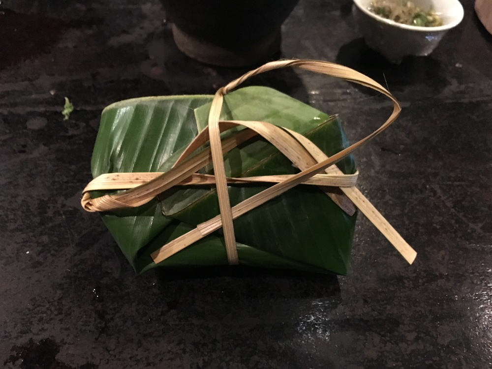 Tilapia wrapped in banana leaf