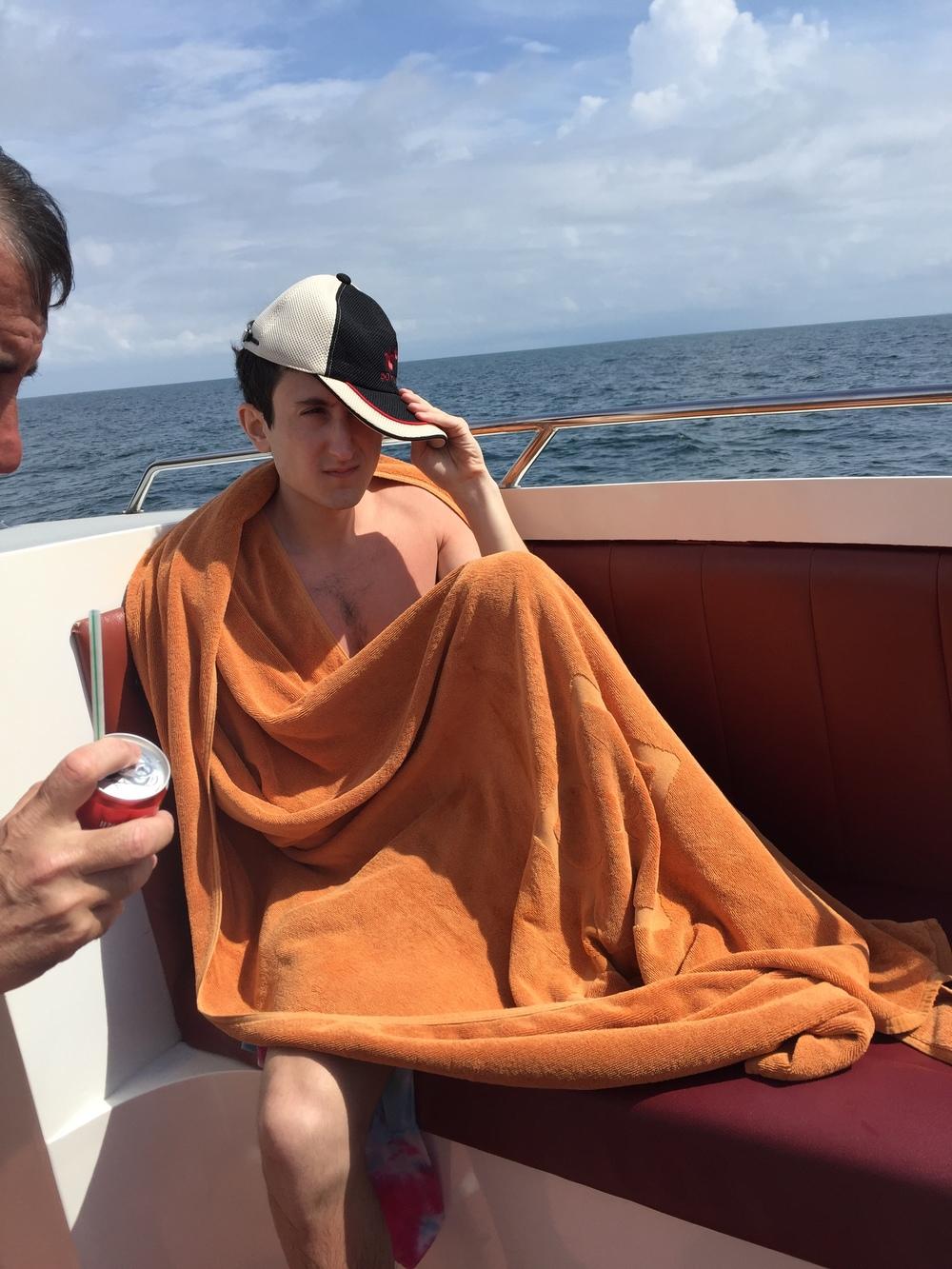 Nursing his sunburn