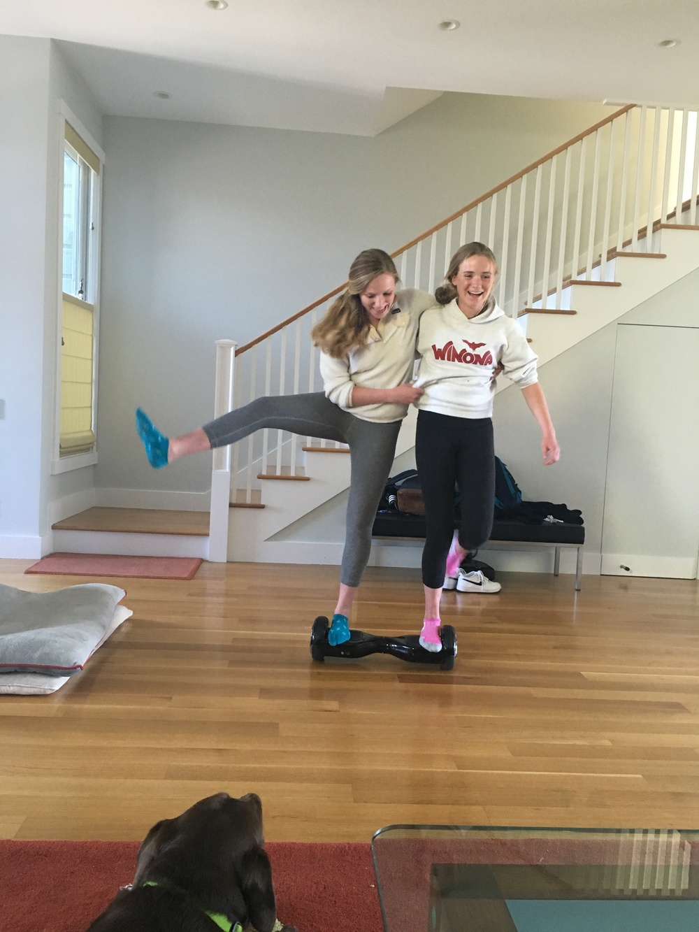 Mia + Cali are acrobats on the hoverboard