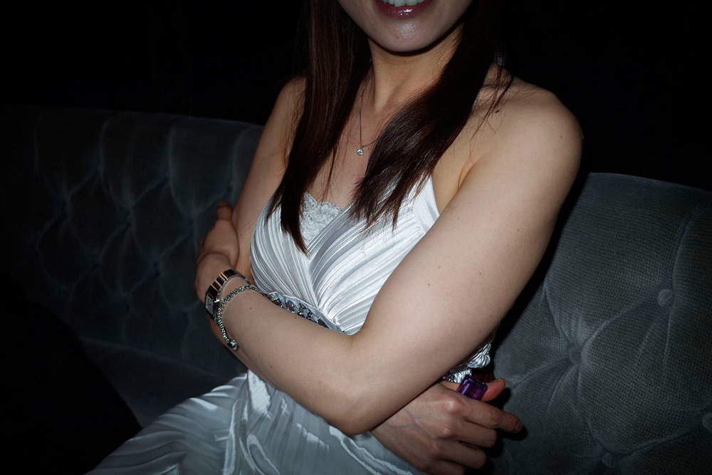 A woman in a white dress at Japanese style bar Sasebo, Japan 2015