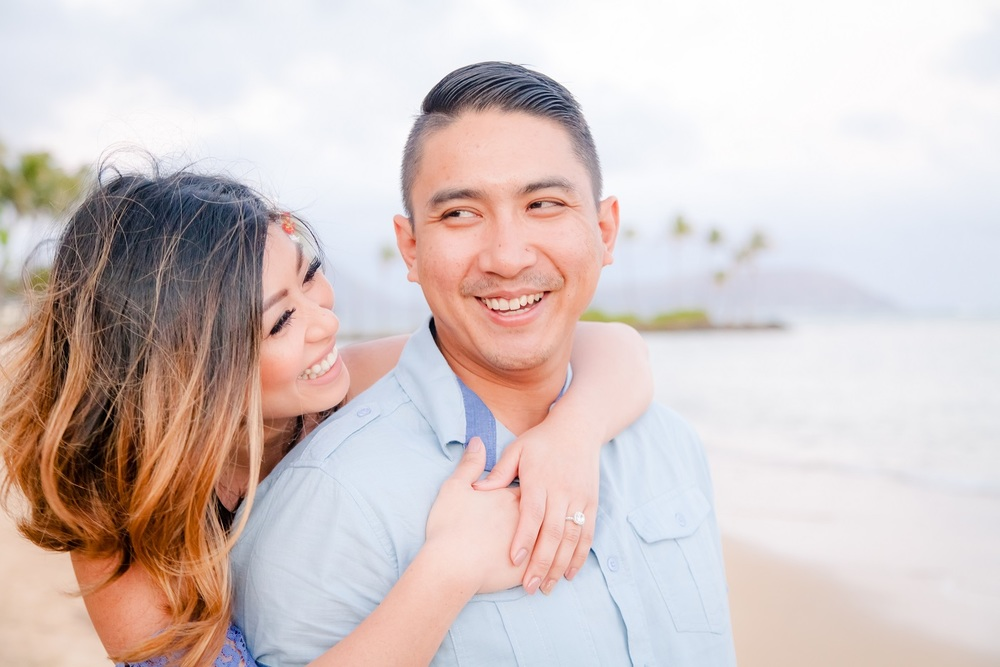 romantic laughing couple oahu beach portrait