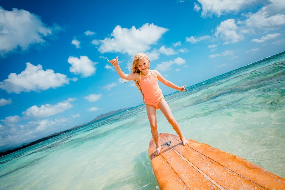 surfer girl kid family beach surfboard portrait