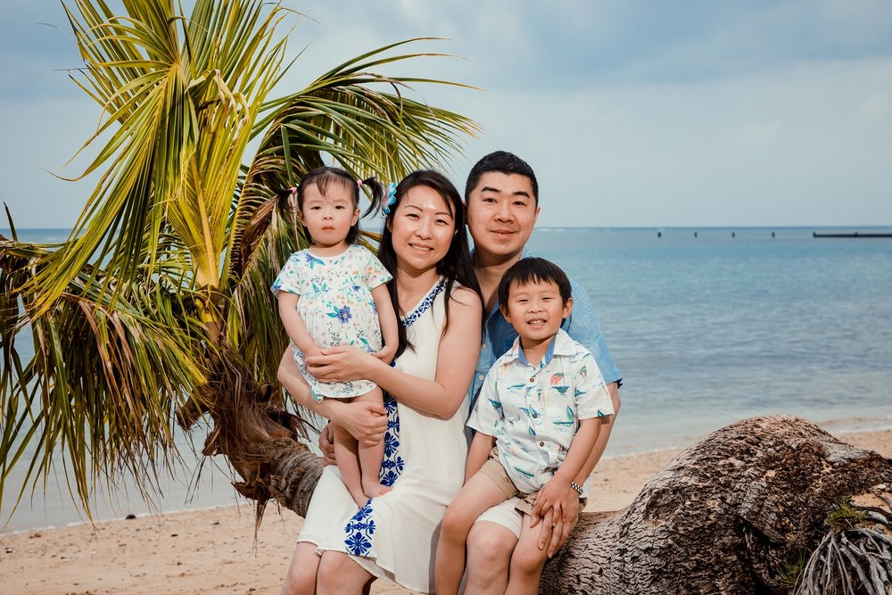 family portrait on beach palm trees kahala hotel resort