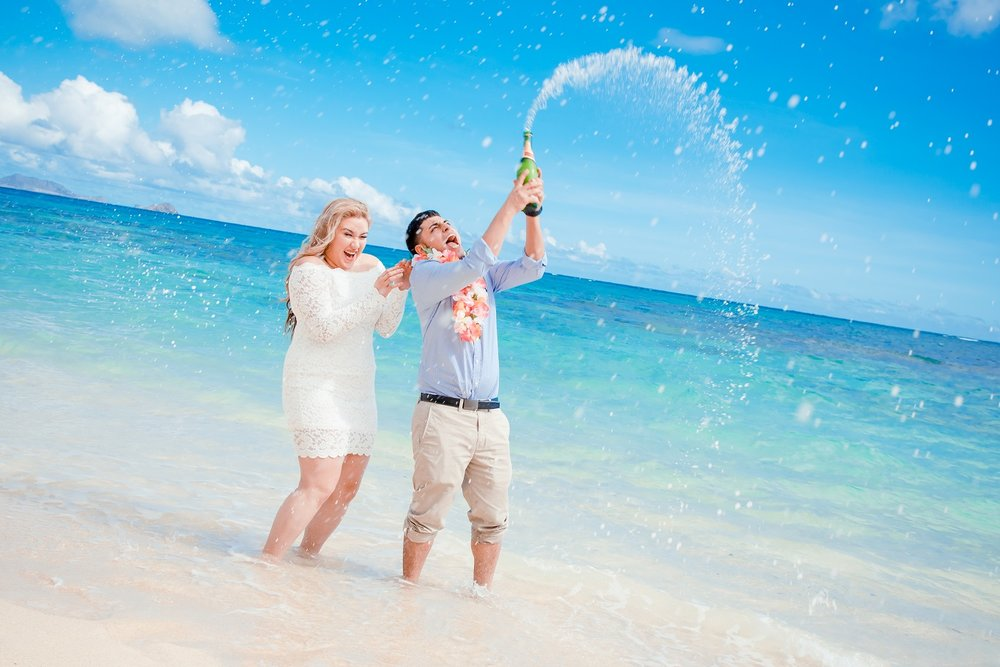 champagne spray engagement proposal beach hawaii