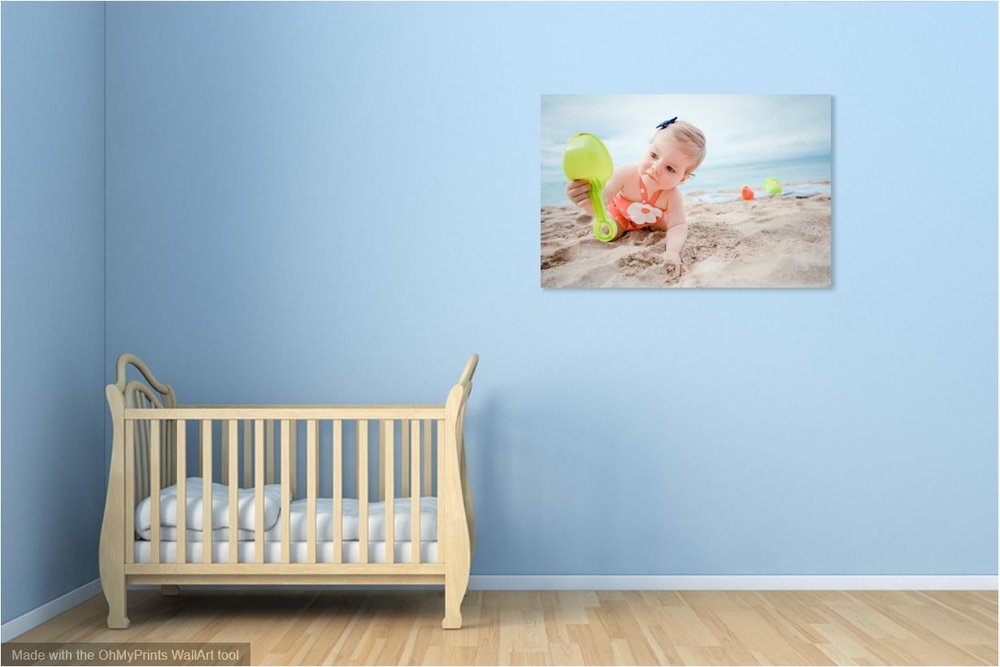baby's room with baby portrait wall art