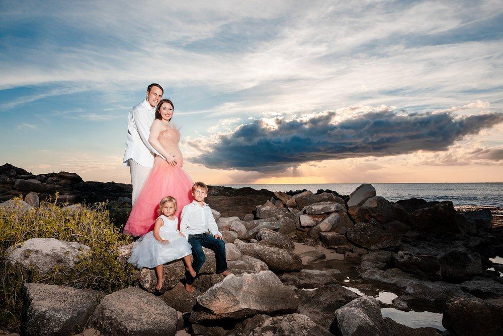 family portrait sunset rocky shore Four Seasons Resort oahu