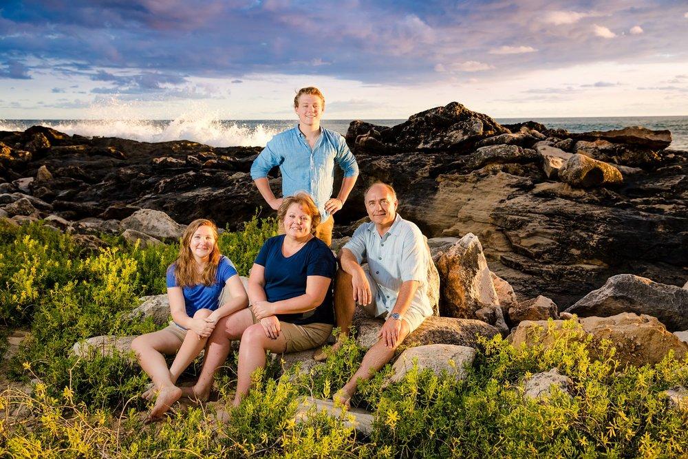 four seasons family portrait photographer sunset rocky shore