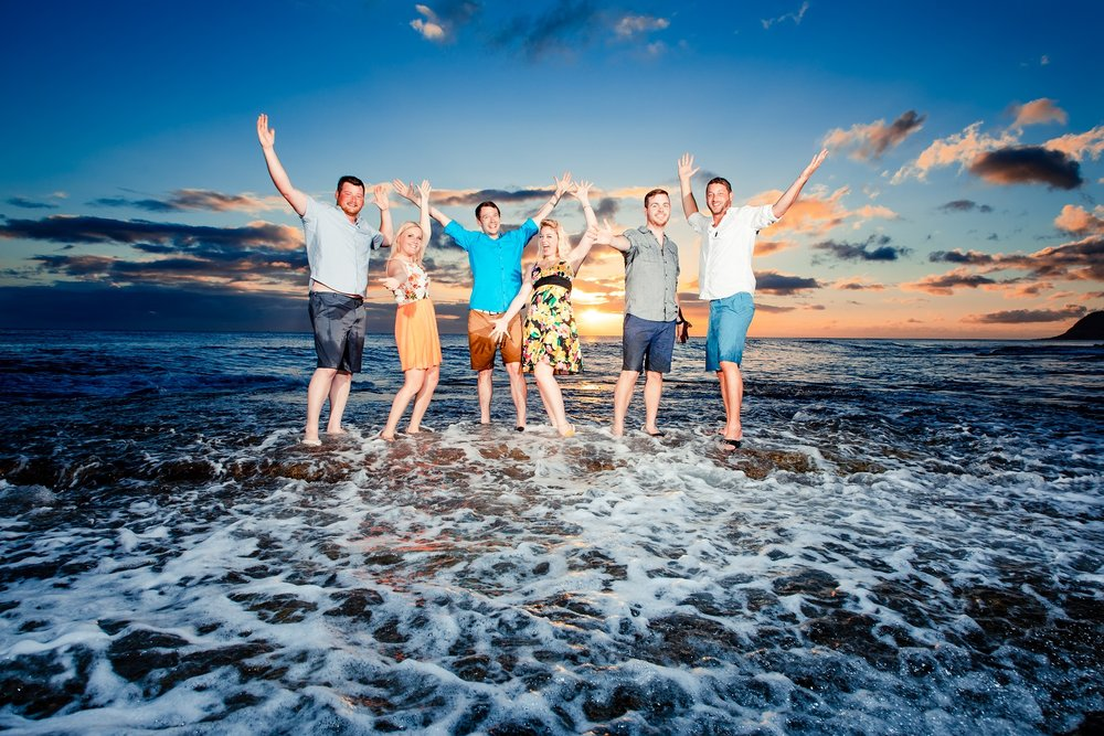 family celebration sunset beach waves